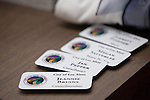 Nametags for the new councilmembers and new mayor are neatly displayed on a table.