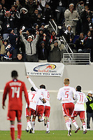Joel Lindpere (20) of the New York Red Bulls celebrates scoring the only goal of the game with Roy Miller (7) and Sinisa Ubiparipovic (8) during the first half of a Major League Soccer match between the New York Red Bulls and the Chicago Fire at Red Bull Arena in Harrison, NJ, on March 27, 2010. The Red Bulls defeated the Fire 1-0.