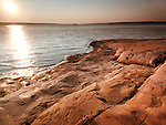 Georgian Bay red rocky shore durng sunrise. Landscape nature scenery at Killbear Provincial Park, Ontario, Canada.