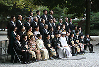The bride, the groom, and guests pose for a wedding photo in Tokyo, Japan, on November 3, 2006. Tokyo, seat of the Japanese government and home of the Japanese Imperial Family, is the Japanese capital, and is ranked fourth global city in the world. Photo by Lucas Schifres/Pictobank