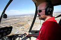 NWA Democrat-Gazette/DAVID GOTTSCHALK   Kyle Flynn, pilot at Arkansas Helicopters of Springdale, flies a Robinson 44 Raven 2 Tuesday, February 7, 2017, from the Springdale Municipal Airport. For the third year, the company is offering Valentine's Day flights.