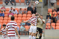 Houston, TX - Friday December 11, 2016: Derek Waldeck (29) of the Stanford Cardinal and Jacori Hayes (8) of the Wake Forest Demon Deacons go up for a loose ball at the NCAA Men's Soccer Finals at BBVA Compass Stadium in Houston Texas.