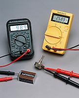DIGITAL MULTIMETERS<br /> Electronic Measuring Instruments<br /> Combining several functions in one unit, a standard multimeter can measure voltage, current (amps) and resistance (ohms). One meter measures voltage in a battery and the other is measuring resistance.
