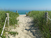 A roped off sandy path descends through the dunes to the beach at Surfside on the south coast of Nantucket Island