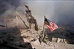Raising the American flag at Ground Zero. Lower Manhattan, New York, NY, September 11, 2001..2001 © Lori GRINKER / CONTACT Press Images
