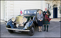 BNPS.co.uk (01202 558833)<br /> Pic: CheshireClassicCars/BNPS<br /> <br /> General Montgomery's granddaughter, Arabella Stuart-Smith, and John Millin, the son of legendary D-Day piper Bill Millin, are shown posing in front of the motor. <br /> <br /> If cars had ears...<br /> <br /> A historic Rolls-Royce belonging to Field Marshall Bernard Montgomery that was used to ferry King George VI, General Eisenhower and Winston Churchill between secret D-Day planning meetings has emerged for sale. <br /> <br /> In the throes of the Second World War the handsome 1936 Phantom III operated as Montgomery's staff car while he was based at Southwick House near Portsmouth alongside Eisenhower. <br /> <br /> It was in the 'map room' at Southwick House that the Allied invasion of Normandy was plotted. <br /> <br /> In recent years the car has been in the hands of a private owner who has now offered it for sale through Cheshire Classic Cars for &pound;200,000.