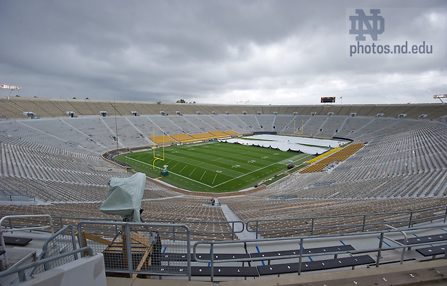 Sept. 22, 2012; Stadium grounds crew cover the field with a tarp as rain showers, some heavy, moved across campus...Photo by Matt Cashore/University of Notre Dame