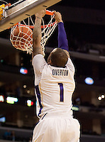 "5'11"" Venoy Overton dunks the ball on the breakaway. The Washington Huskies defeated the Oregon State Beavers 59-52 during the Pac-10 Tournament at the Staples Center in Los Angeles, California on March 11th, 2010."