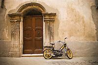 Motorscooter parked in front of old building, Sospel, France