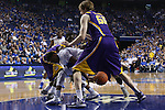 UK sophomore guard Ryan Harrow reaching for the ball while being guarded by LSU sophomore forward Johnny O'Bryant III and senior center Andrew Del Piero during the first half of the men's basketball game vs. LSU at Rupp Arena on Saturday, January 26, 2013, in Lexington, Ky. Photo by Kalyn Bradford | Staff
