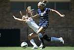 09 September 2012: Marquete's Rachel Brown (17) pushes Duke's Kaitlyn Kerr (behind) off of the ball. The Duke University Blue Devils defeated the Marquette University Golden Eagles 5-2 at Koskinen Stadium in Durham, North Carolina in a 2012 NCAA Division I Women's Soccer game.
