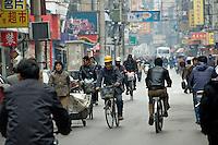 A crowded street in Shanghai..Shanghai, February 2006.