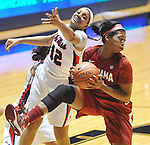 Mississippi's Monique Jackson (42) and Alabama's Kaneisha Horn (40)  go for a rebound in NCAA women's basketball action in Oxford, Miss. on Sunday, January 13, 2013.  Alabama won 83-75. (AP Photo/Oxford Eagle, Bruce Newman)