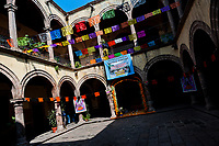 Chiseled paper flags (papel picado) are hung in the patio of a colonial house during the Day of the Dead celebration in Morelia, Michoacán, Mexico, 1 November 2014. Day of the Dead ('Día de Muertos') is a syncretic religious holiday, celebrated throughout Mexico, combining the death veneration rituals of the ancient Aztec culture with the Catholic practice. Based on the belief that the souls of the departed may come back to this world on that day, people gather on the gravesites praying, drinking and playing music, to joyfully remember friends or family members who have died and to support their souls on the spiritual journey.