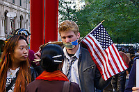 Occupy $10 bill taped to a protester's face, at the Occupy Wall Street Protest in New York City October 6, 2011.