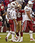 Arizona Cardinals quarterback Jake Plummer (16) and San Francisco 49ers defensive back Jason Webster (36) after interception on Sunday, October 27, 2002, in San Francisco, California. The 49ers defeated the Cardinals 38-28.