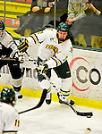 5 February 2011: University of Vermont Catamount forward Josh Burrows, a Senior from Prairie Grove, IL, in action against the Providence College Friars at Gutterson Fieldhouse in Burlington, Vermont. The Catamounts defeated the Friars 7-1 in the second game of their weekend series. Mandatory Credit: Ed Wolfstein Photo