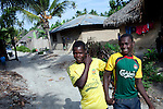PEMBA, TANZANIA - DECEMBER 7 : Hamissi Usi, age 15, with his best friend outside his home on December 7, 2010 on Pemba, Tanzania. He works as a fisherman. He doesn't go to school but lives with his parents and siblings in the small village of Tumbe. (Photo by: Per-Anders Pettersson)