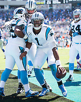 The Carolina Panthers played the New York Giants at Bank of America Stadium in Charlotte, NC.  The Panthers won 38-0 for their first victory of the season.  The Giants dropped to 0-3.  Carolina Panthers quarterback Cam Newton (1) celebrates a touchdown run by Carolina Panthers fullback Mike Tolbert (35)