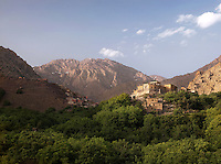 A kasbah sits in the hills below Mount Toubkal at Imlil in Toubkal National Park, Morocco