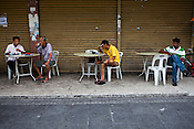 Locals gather to eat outside a kopitiam in capital Georgetown of Penang in Malaysia, India. Photo: Sanjit Das/Panos