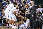 Players of each team help fellow teammates up after diving to save the ball during Wildcats game against the Mississippi State Bulldogs at Rupp Arena on January 20, 2015 in Lexington, Kentucky. Photo by Taylor Pence
