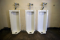 A row of urinals in a men's restroom in New York on Saturday, April 25, 2015.  (© Richard B. Levine)