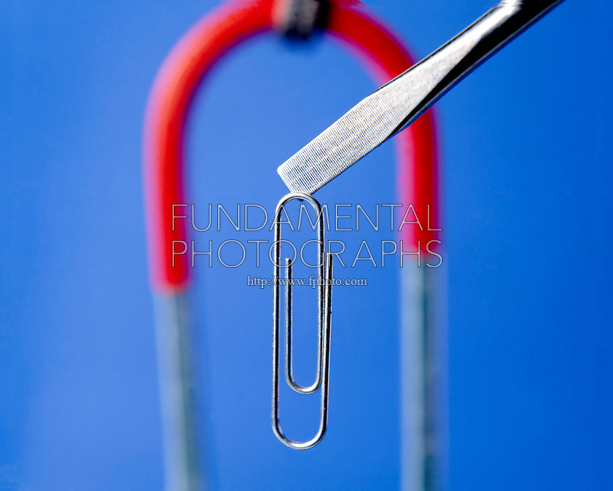 TEMPORARY MAGNET: FERROMAGNETISM<br /> Magnetized nail suspends paper clip