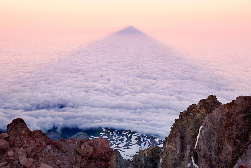 """THE MOUNTAIN SHADOW"" -- A rarely seen mountain shadow shows up just after sunrise. Seen from the summit of Oregon's Mount Hood, looking west."