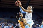 11 November 2013: North Carolina's Allisha Gray (15) is called for a charge against Tennessee's Andraya Carter (14) on this play. The University of North Carolina Tar Heels played the University of Tennessee Lady Vols in an NCAA Division I women's basketball game at Carmichael Arena in Chapel Hill, North Carolina. Tennessee won the game 81-65.