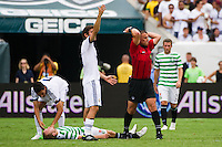Referee Sorin Stoica calls for a stretcher as Dylan McGeouch (46) of Celtic F. C. lays motionless on the turf after being injured on a header. Real Madrid defeated Celtic F. C. 2-0 during a 2012 Herbalife World Football Challenge match at Lincoln Financial Field in Philadelphia, PA, on August 11, 2012.