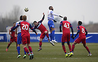 Sandro of QPR wins a header against Shaun Maloney of Chicago Fire