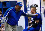 Assistant Coach Jon Collins jokes with his son Will Thomas Collins during halftime at Breathitt County High School on Friday Oct. 14, 2011. The Bobcats played Morgan County and were ahead at halftime 41-8.  Photo by Rachel Aretakis