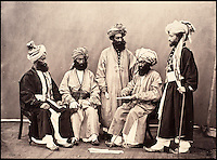 BNPS.co.uk (01202 558833)<br /> Pic: DominicWinter/BNPS<br /> <br /> A group of Kabulese men in Peshawur.<br /> <br /> Fascinating 150 year-old photographs of India taken in the aftermath of the failed mutiny have sold for almost &pound;8,000 at auction.<br /> <br /> The images, which date from 1863 to 1870, capture native soldiers with their weapons and picturesque landscapes and were taken by celebrated 19th century photographer Samuel Bourne.<br /> <br /> They went for a hammer price of &pound;6,400 to a private collector from America who bid online with extra fees pushing the overall price above &pound;7,800.<br /> <br /> Together with Charles Shepherd, Bourne set up photo studio Bourne &amp; Shepherd first in Simla in 1863 and later in Calcutta.