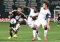 Cristian Castillo #12 of D.C. United battles against Emmanuel Osei #5 and Kevin Alston #30 of the New England Revolution during an MLS match on April 3 2010, at RFK Stadium in Washington D.C.
