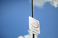 Sign promoting a 20 MPH speed limit on Waterloo Bridge in London, seen against a bright blue sky