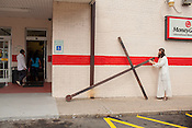 "Dean Padgett parks his cross outside of Los Primos on Alston Avenue before a bathroom break.  ""The greatest sin is doing nothing, it's the greatest selfishness of all,"" he says."