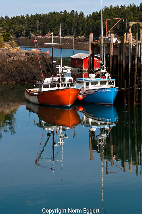 Red and Blue Fishing Boats docked in Head Harbor, Campobello Island, New Brunswick, Canada