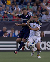 Philadelphia Union midfielder Kyle Nakazawa (13) drives for the net as New England Revolution midfielder Chris Tierney (8) defends. In a Major League Soccer (MLS) match, the Philadelphia Union defeated the New England Revolution, 3-0, at Gillette Stadium on July 17, 2011.