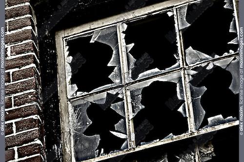 Broken glass of an abondoned building window