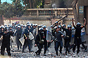 Egyptian security forces charge nearby protestors during demonstrations November 22, 2011 near Tahrir square in central Cairo, Egypt. Thousands of protestors demanding the military cede power to a civilian government authority clashed with Egyptian security forces for a fourth straight day in Cairo, with hundreds injured and at least 29 protestors killed.  (Photo by Scott Nelson)