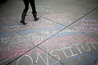 Detail of a chalk message on the sidewalk at the Occupy New Hampshire and Occupy the Primary gathering in Veterans Memorial Park in Manchester, New Hampshire on Jan. 7, 2012.  The New Hampshire GOP presidential primary is on Jan. 10.
