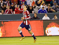 Chivas USA midfielder Sacha Kljestan (16) begins to celebrate his goal. CD Chivas USA defeated the San Jose Earthquakes 3-2 at the  at Home Depot Center stadium in Carson, California on Saturday April 24, 2010.  .