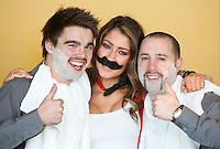 """NO REPRO FEE. 10/11/2011. Miss Universe Ireland Aoife Hannon with Sandy Cole and Christopher White are pictured at the Gibson Hotel Dublin in aid of Movember. The gibson hotel is rockin' a lot of Mo love this November all in aid of Movember, the phenomenal moustache growing global campaign to raise awareness and funds for men's health especially prostate cancer. Today, Thursday 10th November, """"Mo Bro' staff at the gibson hotel were joined by Miss Universe Ireland Aoife Hannon and Neil Rooney from Movember Ireland to show how the gibson hotel's Movember antics are """"growing"""" along!One of Dublin's hippest venues, the gibson hotel right in the heart of our emerging music and cultural hub in the Docklands is proud to embrace Movember with gusto with 12 staff members signed up for the annual moustache growing challenge and the hotel will be donating €1 from every Bacardi Mojito and bottle of Corona sold during the month of November. They have also built a custom made """"Get your Mo On"""" carnival board for anyone passing through the hotel to try on a mo , have their picture taken and make a donation to Movember. Picture James Horan/Collins"""