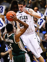 INDIANAPOLIS, IN - FEBRUARY 13: Kellen Dunham #24 of the Butler Bulldogs defends as E. Victor Nickerson #5 of the Charlotte 49ers holds the ball at Hinkle Fieldhouse on February 13, 2013 in Indianapolis, Indiana. Charlotte defeated Butler 71-67. (Photo by Michael Hickey/Getty Images) *** Local Caption *** Kellen Dunham; E. Victor Nickerson