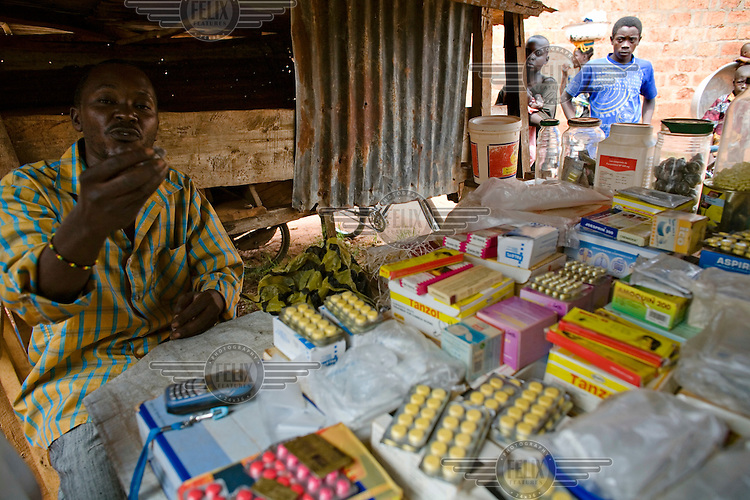 A medicine vendor selling pills and tablets in the market.