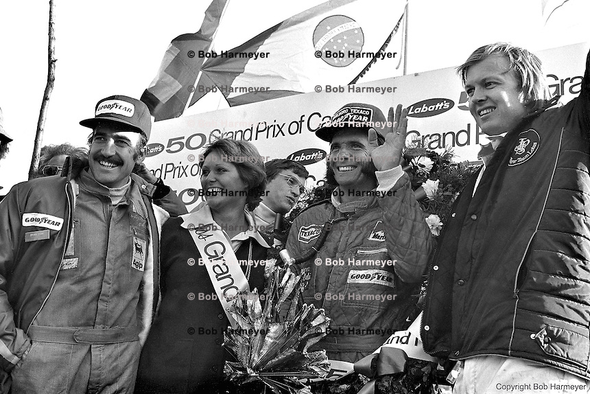 BOWMANVILLE, ON - SEPTEMBER 22, 1974: Clay Regazzoni, Emerson Fittipaldi and Ronnie Peterson (L-R) with 'Miss Grand Prix' in victory lane at the 1974 Canadian Grand Prix at Mosport International Raceway near Bowmanville, Ontario, Canada.