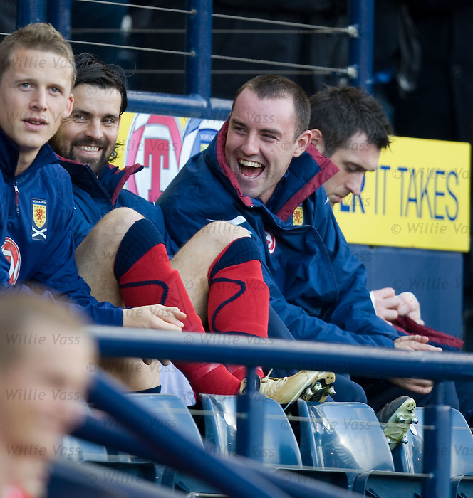 Kris Boyd sitting on the bench with Paul Hartley
