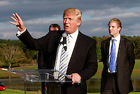Oct. 04, 2011 - Charlottesville, VA. USA; Donald Trump speaks in front of son Eric Trump, right, during a press conference announcing the grand opening of Trump Vineyard Estates Tuesday in Charlottesville, Va. Trump purchased the foreclosed vineyard, previously owner by Patricia Kluge, at auction earlier this year. The 2,000 acre Trump Vineyard estate is also the home to Trump Winery, helmed by Donald's son Eric Trump.  (Credit Image: © Andrew Shurtleff)