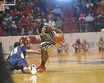 "Ole Miss guard Chris Warren (12) dribbles as East Tennessee State's Adam Sollazzo (43) defends at the C.M. ""Tad"" Smith Coliseum in Oxford, Miss. on Saturday, December 18, 2010. Ole Miss won 71-50 and Warren scored 22 points."